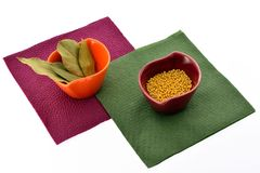 Spices in cups on napkins Stock Photos
