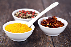 Spices Curry, Peppers Mix and paprika Royalty Free Stock Images