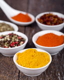 Spices Curry, Peppers Mix and paprika Royalty Free Stock Photos