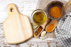 Spices with cutting board Stock Image
