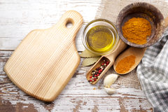 Spices with cutting board Stock Photos