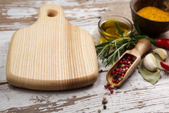 Spices with cutting board Royalty Free Stock Images
