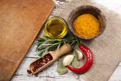 Spices with cutting board Stock Photography