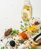 Spices in different spoons on a stone white background. A scattering of spices. Stock Photo