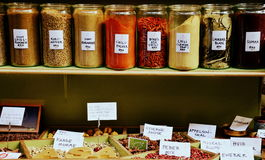 Spices on display. Various spices inside glass jars and in bulk inside the market of Torvehallerne, in Copenhagen, Denmark Royalty Free Stock Photo
