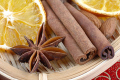Spices and dried orange Stock Photos