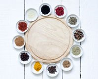 Spices and dried vegetables with cutting board Stock Images