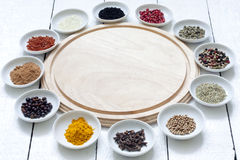 Spices and dried vegetables with cutting board Stock Photos