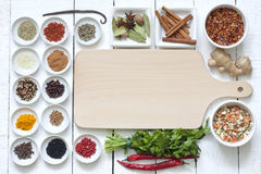 Spices and dried vegetables with cutting board Royalty Free Stock Images