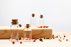 Spices and empty, small glass bottles Stock Image