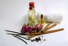 Spices, flowers, aromatherapy oil. Spices, flowers, towel and bottles with aromatherapy oil on grey background Stock Images