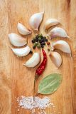 Spices in form of flower on old chopping board Royalty Free Stock Images