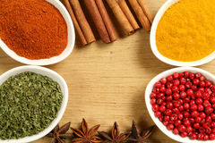 Spices frame. Colorful frame of spices in  ceramic containers Stock Photos