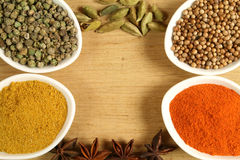 Spices frame. Spices in ceramic containers - colorful frame Stock Images