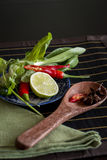 Spices, fresh herbs and lemon in a kitchen Royalty Free Stock Photography