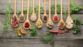 Spices and fresh herbs on a wooden table stock video