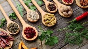 Spices and fresh herbs on a wooden table stock footage
