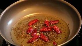 Spices are fried in a frying pan