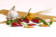 Spices. Garlic, chili pepper and spaghetti are the main ingredients fpr a great dish of pasta royalty free stock photography