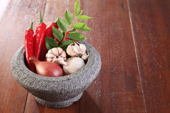 Spices. Garlic,onion,curry leaf and chilli with mortar for spicy thai ingredient Royalty Free Stock Photos