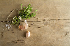 Spices (garlic, thyme, see salt, black peppercorns)  Royalty Free Stock Image