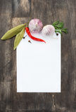 Spices and garlic on wooden background with paper for notes Stock Image