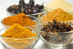 Spices in glass bowls Stock Images
