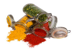 Spices in glass containers. Three kinds of spices in glass containers isolated on white Stock Photography