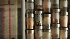 Spices in glass jars stock video footage
