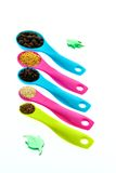 Spices and grains on measuring spoons Stock Photos