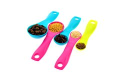 Spices and grains on measuring spoons Royalty Free Stock Photography