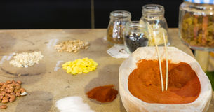 Spices and grains on the table Stock Images