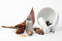 Spices, grater and mortar Stock Photo