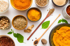 Spices for heath and cooking on white background. Stock Images