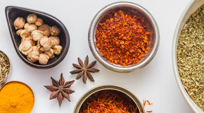 Spices for heath and cooking on white background. Royalty Free Stock Photo