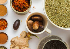 Spices for heath and cooking on white background. Stock Photos