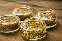 Spices and herbal tea ingredients on glass jars Stock Photo