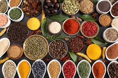 Spices and herbs. Aromatic spices and herbs in metal and ceramic bowls. Top view royalty free stock photos