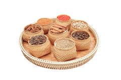 Spices, herbs in bamboo basket isolated on white background Stock Photography
