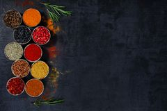 Spices and herbs on a black background.  royalty free stock images