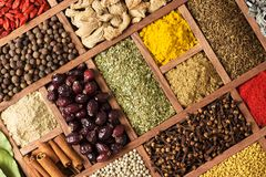 Various condiments  with showcases of  Indian market. Colorful spices and herbs as a background for design stock photography