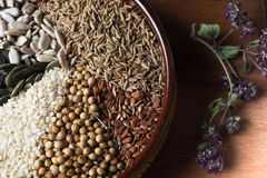 Spices and herbs in ceramic bowl. seasoning. Colorful natural ad Stock Photos