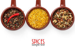 Spices and herbs in ceramic bowls. Stock Photo