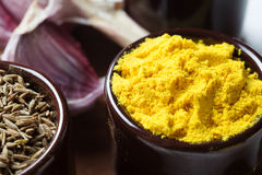 Spices and herbs in ceramic bowls. curcuma and zira seasoning. C Royalty Free Stock Image