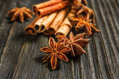 Spices and herbs. Food and cuisine ingredients. Cinnamon sticks,. Anise stars, Cloves on textured background Stock Image