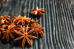 Spices and herbs. Food and cuisine ingredients. Cinnamon sticks,. Anise stars, Cloves on textured background Royalty Free Stock Image
