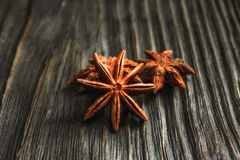 Spices and herbs. Food and cuisine ingredients. Cinnamon sticks,. Anise stars,  Cloves on textured background Stock Photos