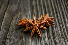 Spices and herbs. Food and cuisine ingredients. Cinnamon sticks,. Anise stars, Cloves on textured background royalty free stock photo