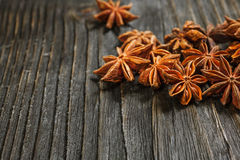Spices and herbs. Food and cuisine ingredients. Cinnamon sticks,. Anise stars,  Cloves on textured background Royalty Free Stock Photos
