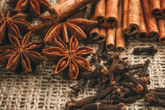 Spices and herbs. Food and cuisine ingredients. Cinnamon sticks,. Anise stars, Cloves on textured background royalty free stock images